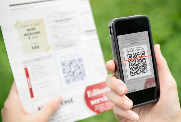 Scanning advertising with QR code on mobile smart phone.